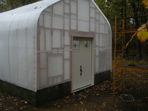 View of Front of Main Greenhouse with Solexx Rolls