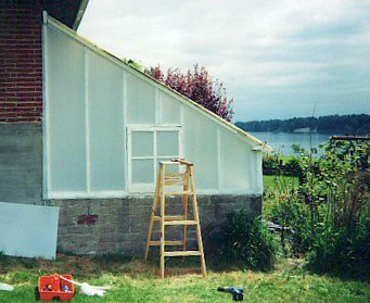 Custom lean to greenhouse using Solexx panels.