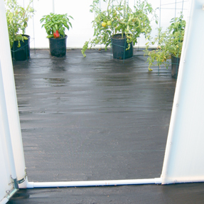 Greenhouse weed blocking flooring