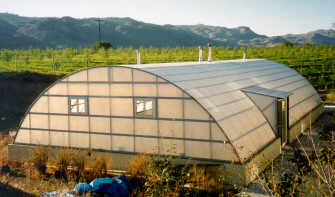 A pool enclosure covered with Solexx greenhouse covering